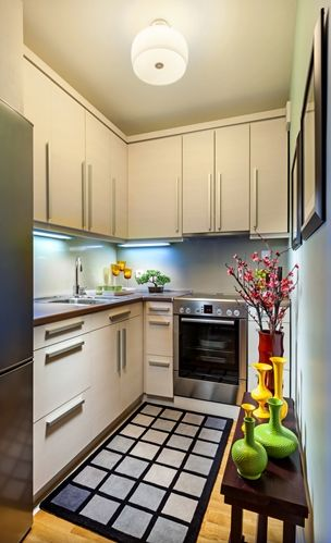 A small kitchen space painted white can help it seem larger  16001529 40043066 0 14108988 500