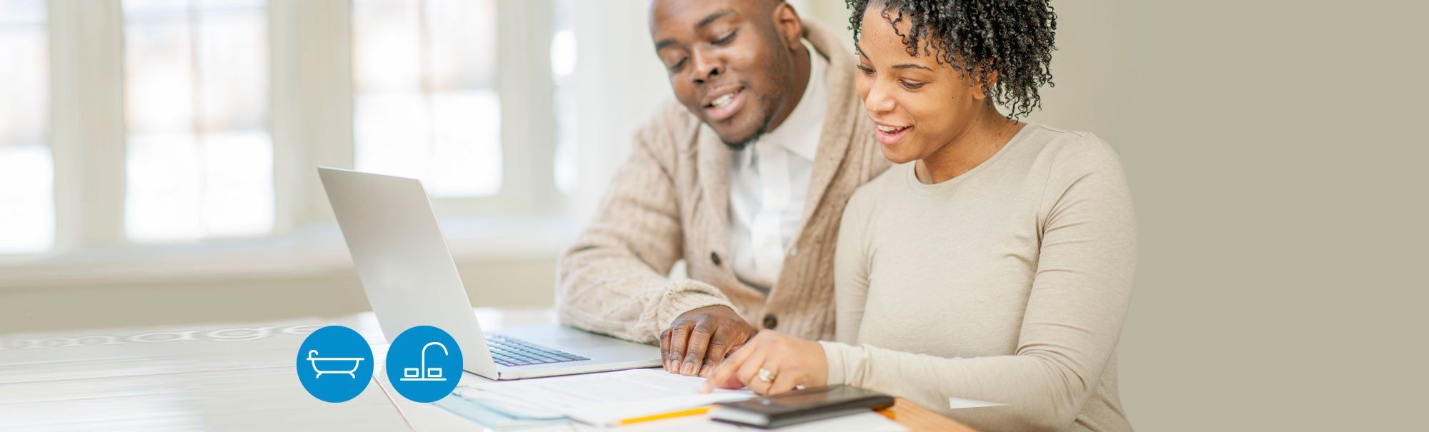 Couple using laptop for budget planning